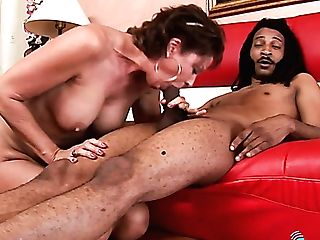 Brief Haired Wild Cougar Gives Deep Throat To Black Stud Before Her Twat Is Fucked